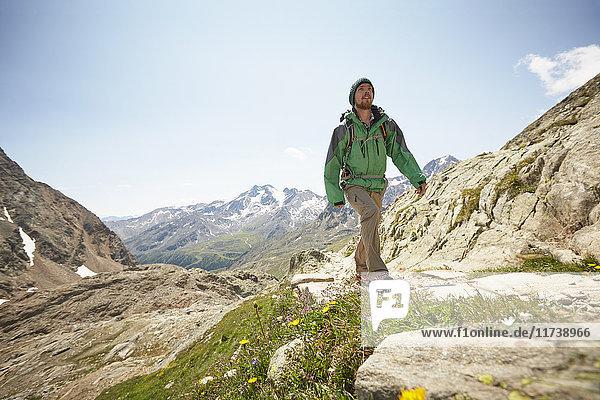 Young male hiker hiking Val Senales Glacier  Val Senales  South Tyrol  Italy
