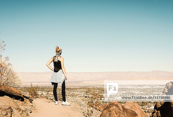 Mid adult hiker looking at view in Palm Springs  California  USA