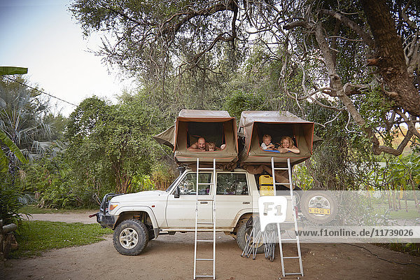 Family in sleeping tents on top of off road vehicle  Ruacana  Owamboland  Namibia