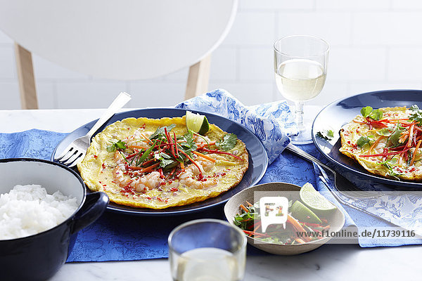 Meal with vietnamese prawn omelette and salad