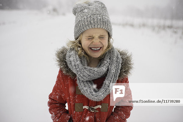 Happy young girl walking in snow