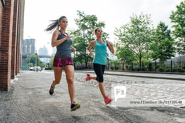 Young women running in Dumbo  Brooklyn  New York  USA