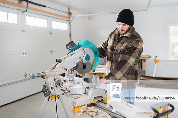 Carpenter working with power tools