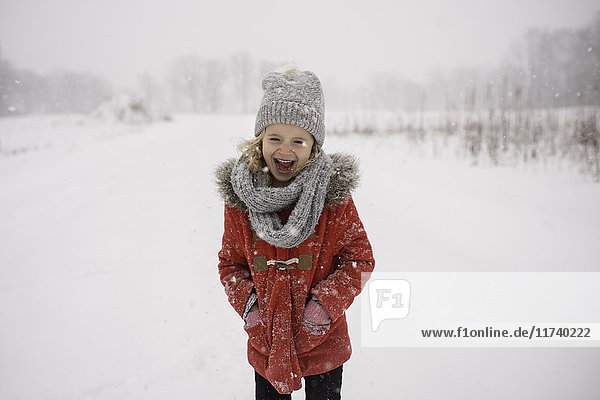 Young girl walking in snow