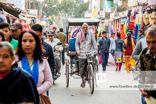 Johri Bazaar  Man driving rickshaw on busy street in Jaipur  India.