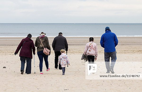 Seaton Carew  County Durham  north east England. United Kingdom. People on the beach on a cold overcast day.