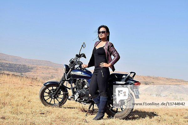 Portrait of a young girl standing near mountain bike posing  Pune  Maharashtra.