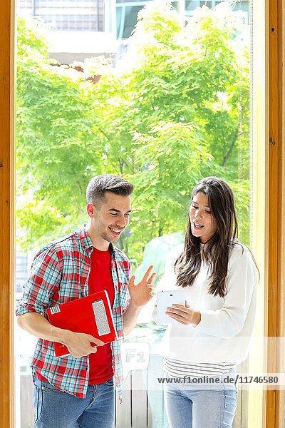 Pair of students with digital tablet  University  Donostia  San Sebastian  Basque Country  Spain