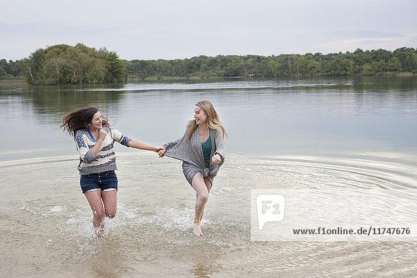 Young women playing in lake