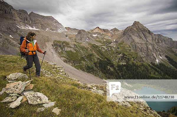 Woman hiking high in the Blues Lakes Basin in the San Juan Mountains  Mount Sneffels Wilderness  Colorado  USA