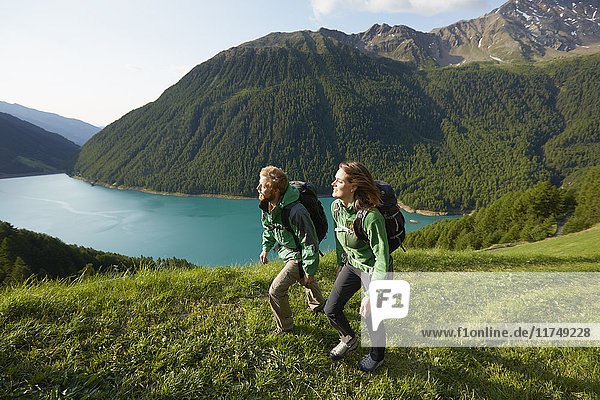 Young couple hiking at Vernagt reservoir  Val Senales  South Tyrol  Italy