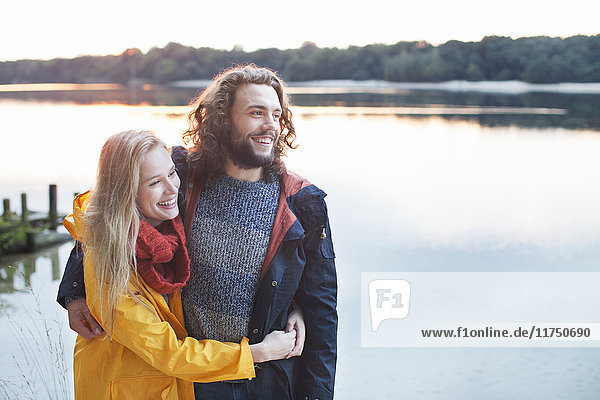 Young couple enjoying lake