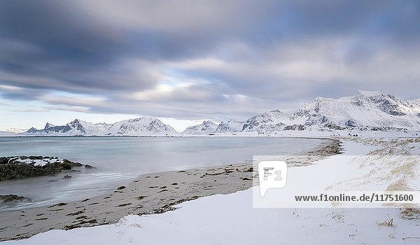Ytresand Beach near village Fredvang  view over to island Flakstadoya. The island Moseknesoya  the Lofoten islands in northern Norway during winter. Europe  Scandinavia  Norway  February.