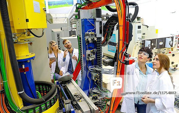 Robotic mobile platform for aeronautical drilling. Researchers working on portable robot to drill holes into aircraft components  Industry  Research and Technology Center  Tecnalia Research & Innovation  Donostia  Basque Country  Spain  Europe