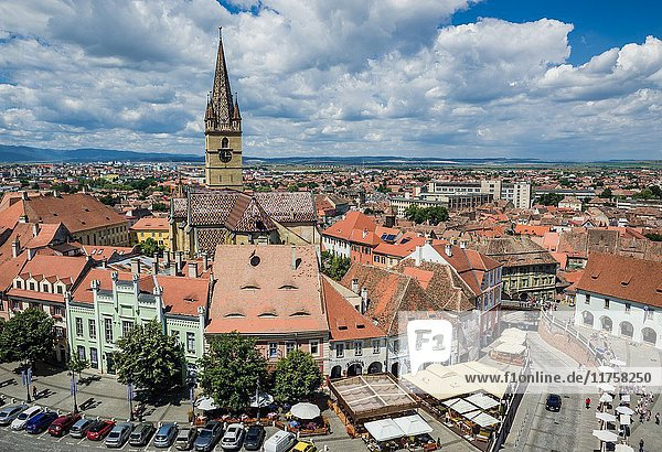 Aerial view from Council Tower with Hermes House (green building) and bell tower of Lutheran Saint Mary Cathedral  Historic Center of Sibiu  Romania.