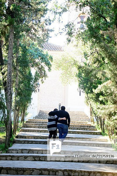 Couple of overweight boyfriends strolls embraced by the park  Alberic  Valencia  Spain