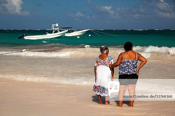 Yucatan woman with traditional clothing at the sandy Tulum beach by the sea  Tulum  Quintana Roo  Mexico  North America