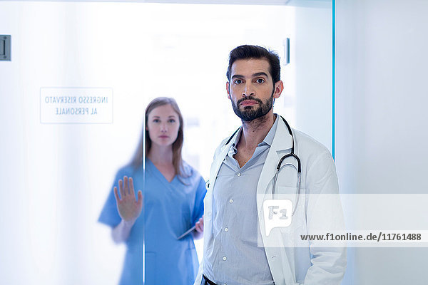 Portrait of doctors in hospital looking at camera