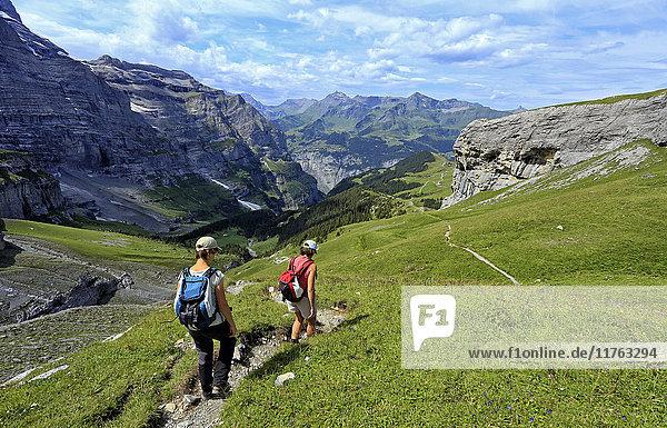 Hikers at Kleine Scheidegg  Grindelwald  Bernese Oberland  Switzerland  Europe