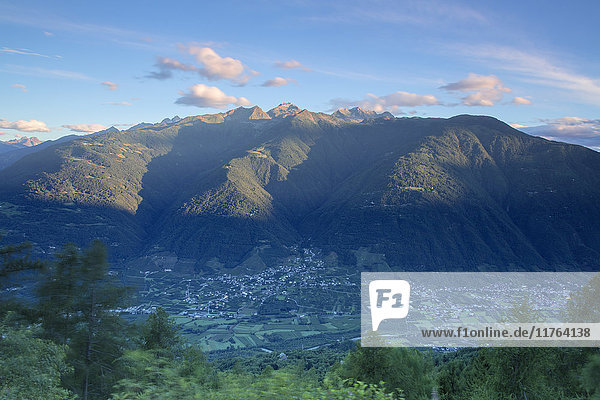 Top view of the village of Bianzone framed by the rocky peaks of the Rhaetian Alps at dawn  Valtellina  Lombardy  Italy  Europe