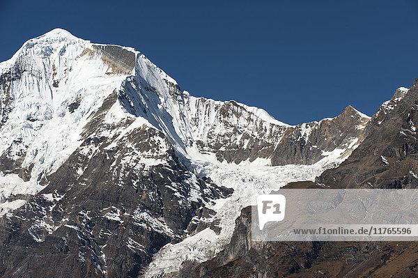 The looming face of Jomolhari  third highest mountain in Bhutan at 7326m  seen from Jangothang  Thimpu District  Bhutan  Himalayas  Asia