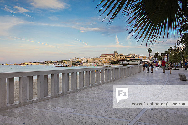 Tourists on the promenade with the medieval old town in the background  Otranto  Province of Lecce  Apulia  Italy  Europe