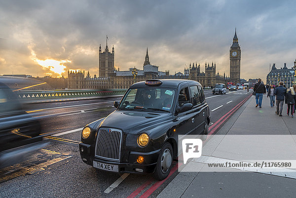 Sunset over a taxi and Big Ben on Westminster Bridge  London  England  United Kingdom  Europe