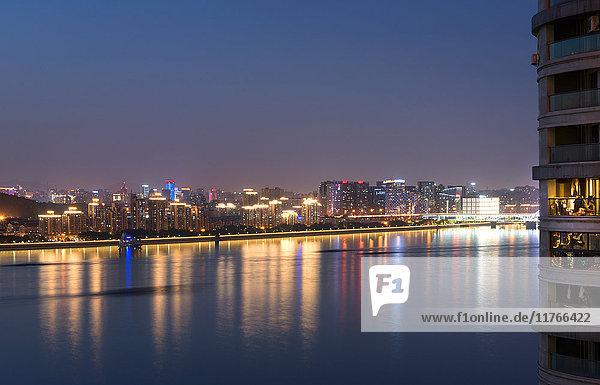 Beautifully illuminated high rises on Qiantang River in Hangzhou  Zhejiang province  China  Asia