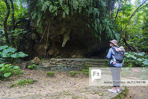 Woman with a baby hiking in the Sacred site of Sefa Utaki  UNESCO World Heritage Site  Okinawa  Japan  Asia