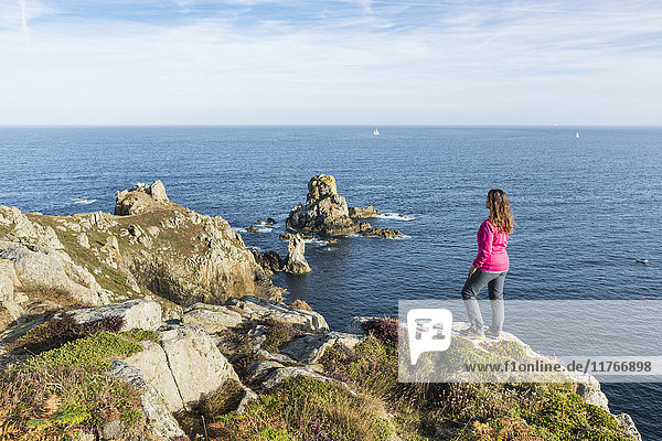 Woman on the cliffs of Van Point  Cleden-Cap-Sizun  Finistere  Brittany  France  Europe