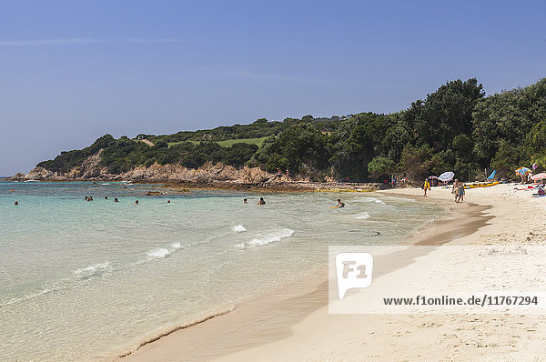 Bathers on sandy beach surrounded by turquoise sea and golf course  Sperone  Bonifacio  South Corsica  France  Mediterranean  Europe