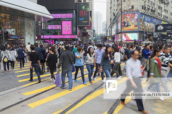 Pedestrians crossing street  Causeway Bay  Hong Kong Island  Hong Kong  China  Asia