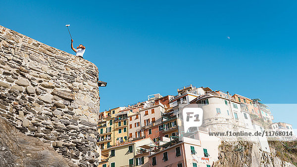 A man taking a selfie at Manarola  Cinque Terre  UNESCO World Heritage Site  Liguria  Italian Riviera  Italy  Europe