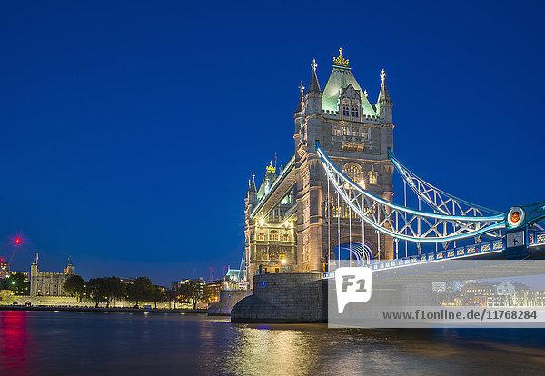 Tower Bridge over River Thames at night  London  England  United Kingdom  Europe