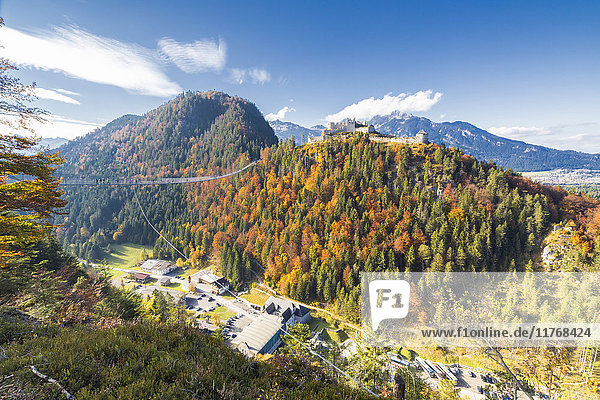 View of the old Ehrenberg Castle surrounded by colorful woods and suspension bridge  Highline 179  Reutte  Austria  Europe