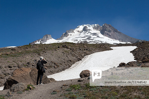 Lady hiker near a glacier on Mount Hood  part of the Cascade Range  Pacific Northwest region  Oregon  United States of America  North America
