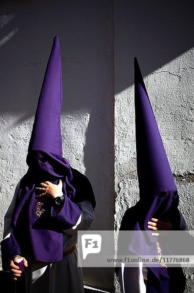Penitents wearing pointed hoods during Easter Week celebrations in Baeza  Jaen Province  Andalusia  Spain.