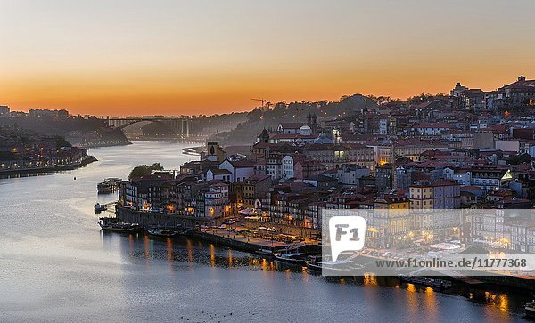 View from Vila Nova de Gaia towards Porto with the old town. City Porto (Oporto) at Rio Douro in the north of Portugal. The old town is listed as UNESCO world heritage. Europe  southern Europe  Portugal  April.