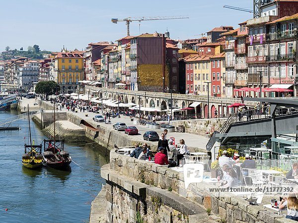 The quarter Ribeira at the old harbour in the old town with the iconic row of houses. City Porto (Oporto) at Rio Douro in the north of Portugal. The old town is listed as UNESCO world heritage. Europe  southern Europe  Portugal  April.