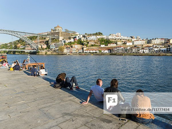 View towards Vila Nova de Gaia on the opposite side of river Douro  where most port wine cellars are located. City Porto (Oporto) at Rio Douro in the north of Portugal. The old town is listed as UNESCO world heritage. Europe  southern Europe  Portugal  April.