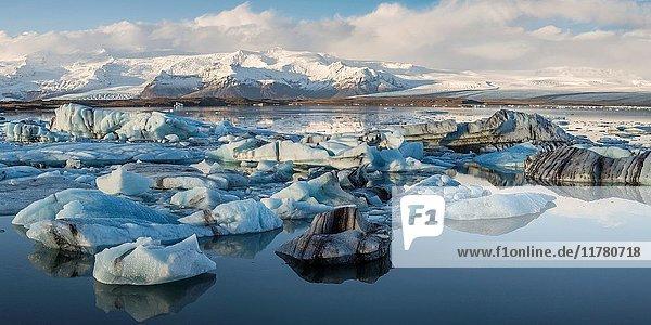 Floating icebergs and Vatnajokull Glacier on the background. Jokulsarlon Glacier Lagoon  Eastern Iceland  Europe.