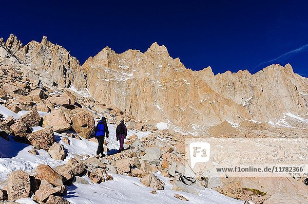 Hikers on the Mount Whitney trail  John Muir Wilderness  Sierra Nevada Mountains  California USA.