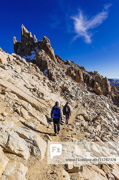 Hikers on the Mount Whitney trail  Sequoia National Park  Sierra Nevada Mountains  California USA.