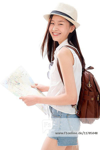 Young woman on travel checking map