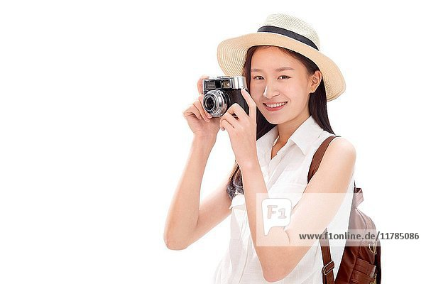 Young woman on travel taking photos