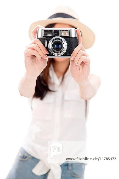 Young woman taking photograph with camera  portrait