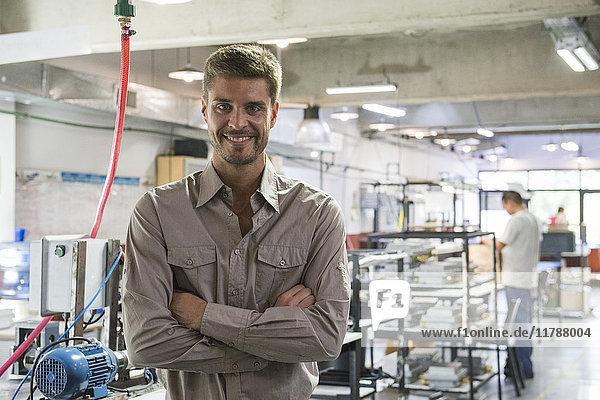 Man smiling in workshop  portrait