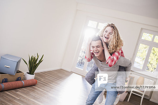 Playful young couple in new home