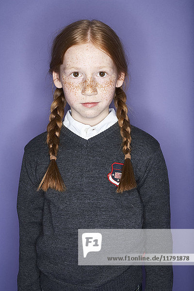 Portrait of redheaded girl with freckles