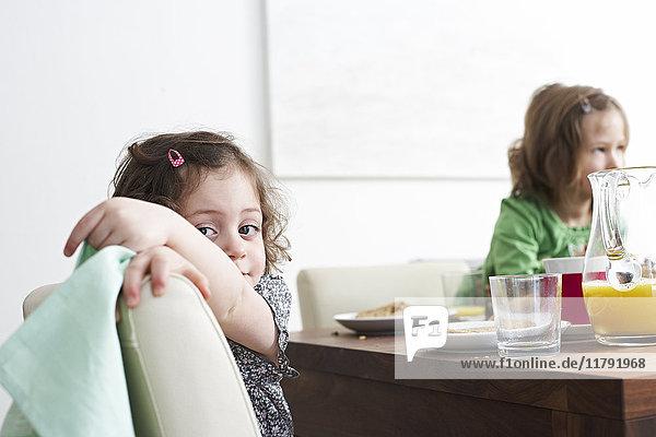 Portrait of little girl at breakfast tablre